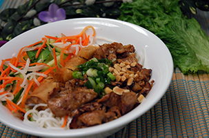 Pho Dui Bo Rice Vermicelli with Grilled Pork & Spring Roll